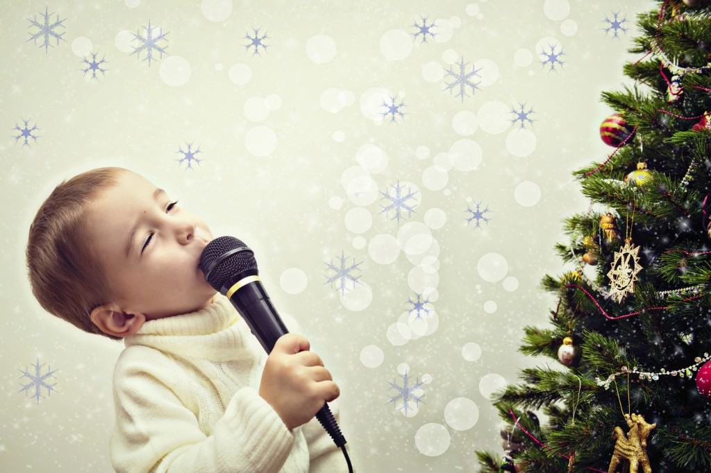 Singing by Christmas Tree