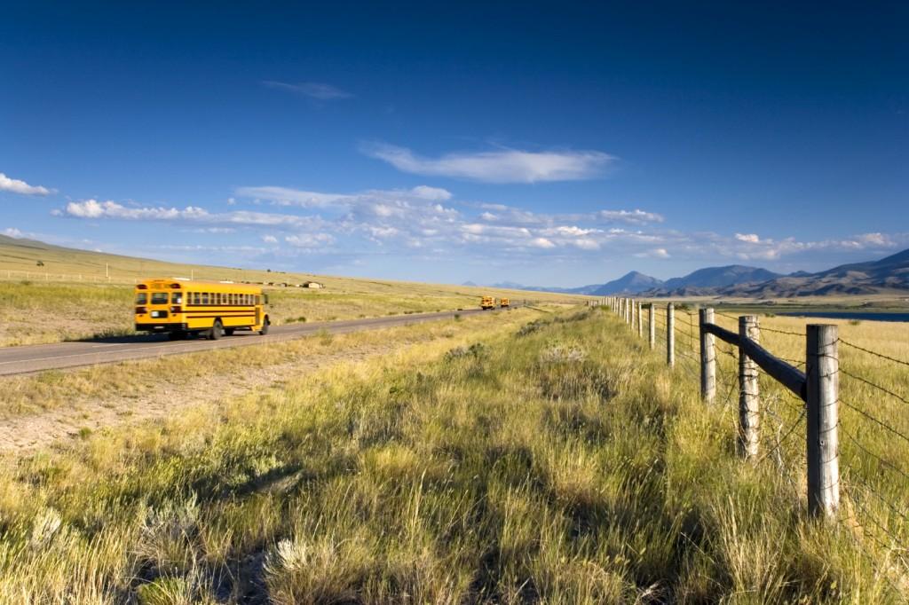 school bus driving along a road