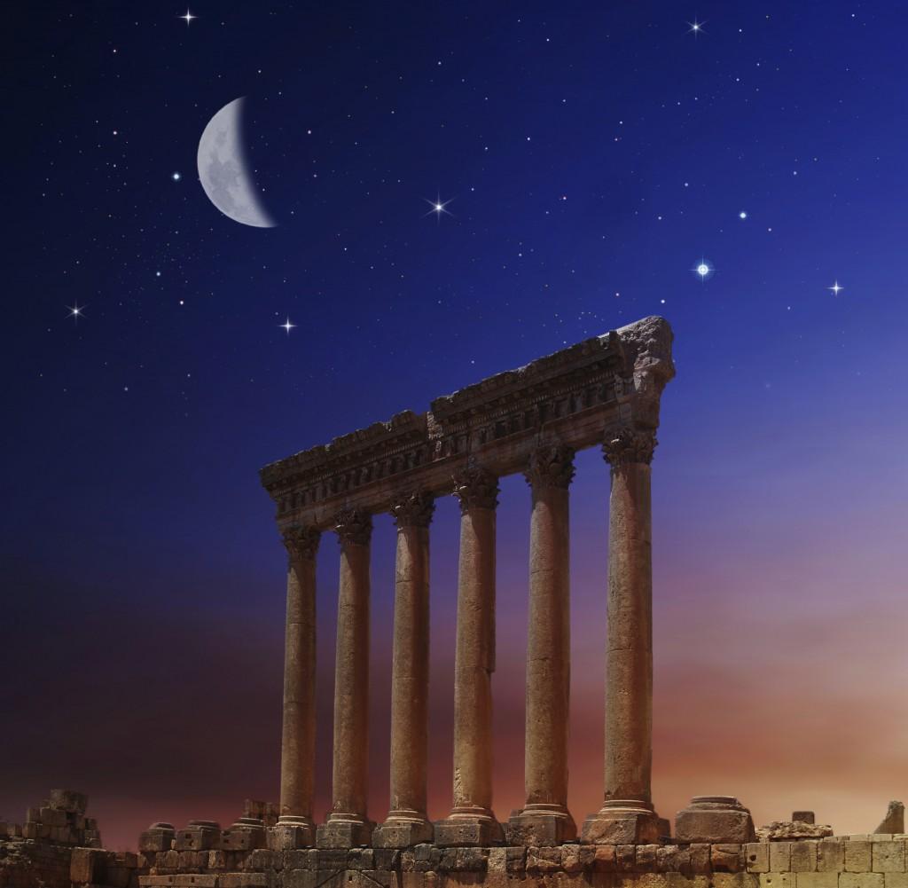 Ancient pillars under moonlight