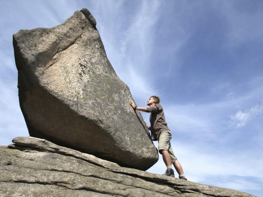 Man struggling with rock climbing