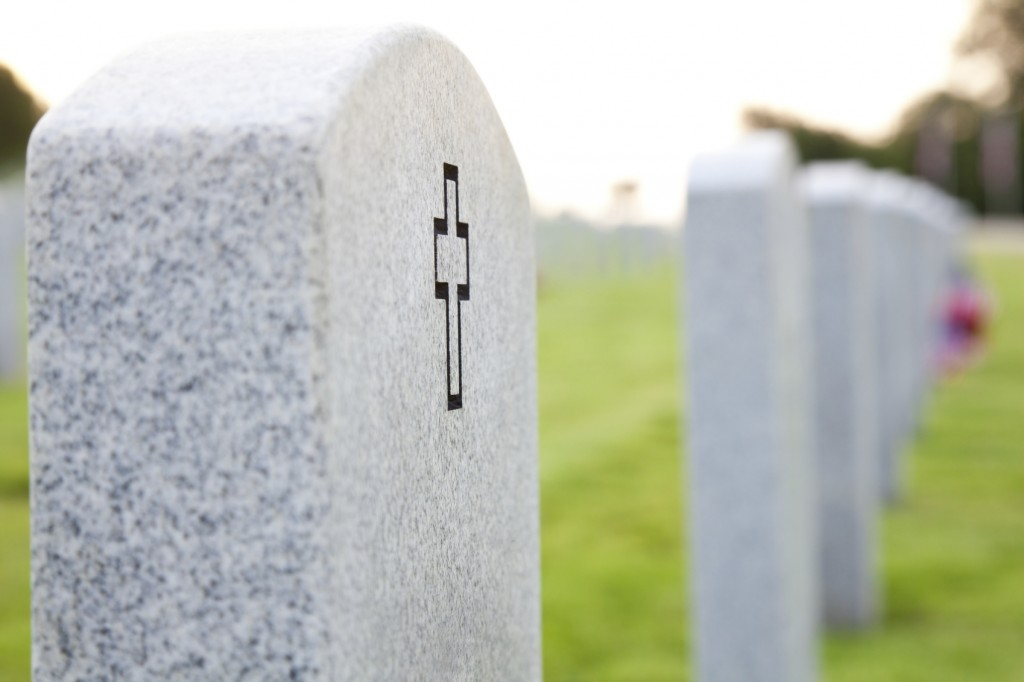 cross headstone in a cemetary