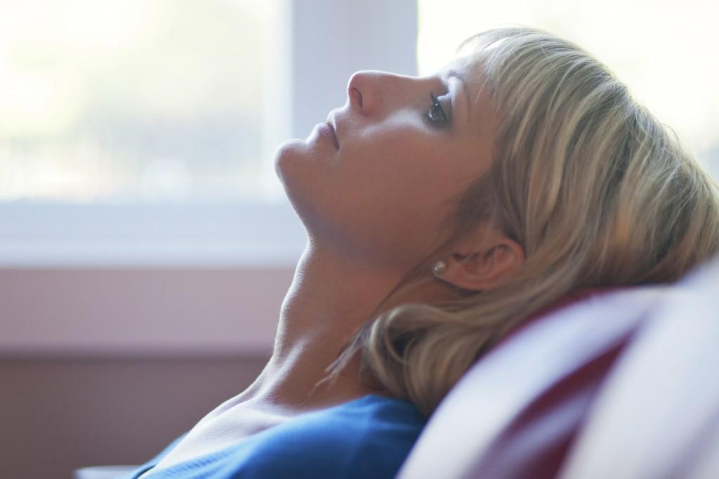 Depressed Woman Laying Back