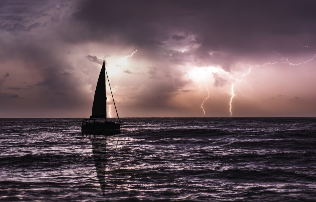 sailboat on stormy seas