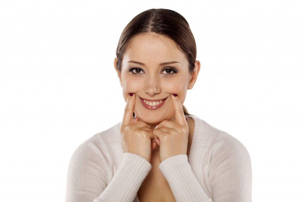 Woman forcing a smile