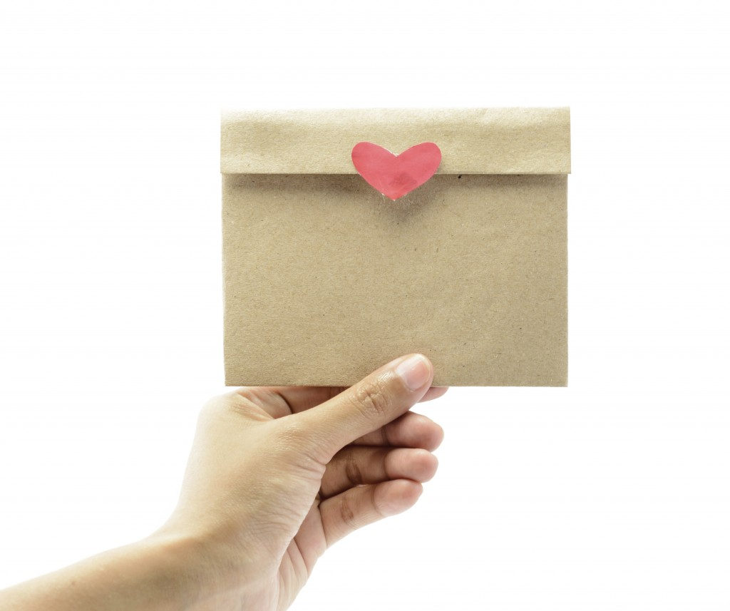 hand hold letter paper