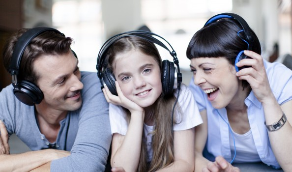 Young family listening to music
