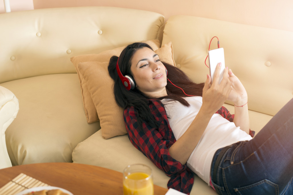 Attractive young woman on the sofa at home