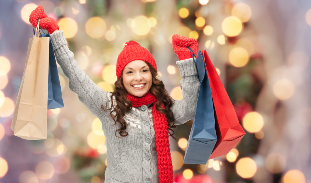 happy woman in winter clothes with shopping bags