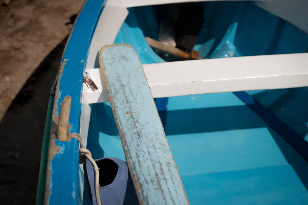 An oar rests in a color fishing boat on the island of Capri