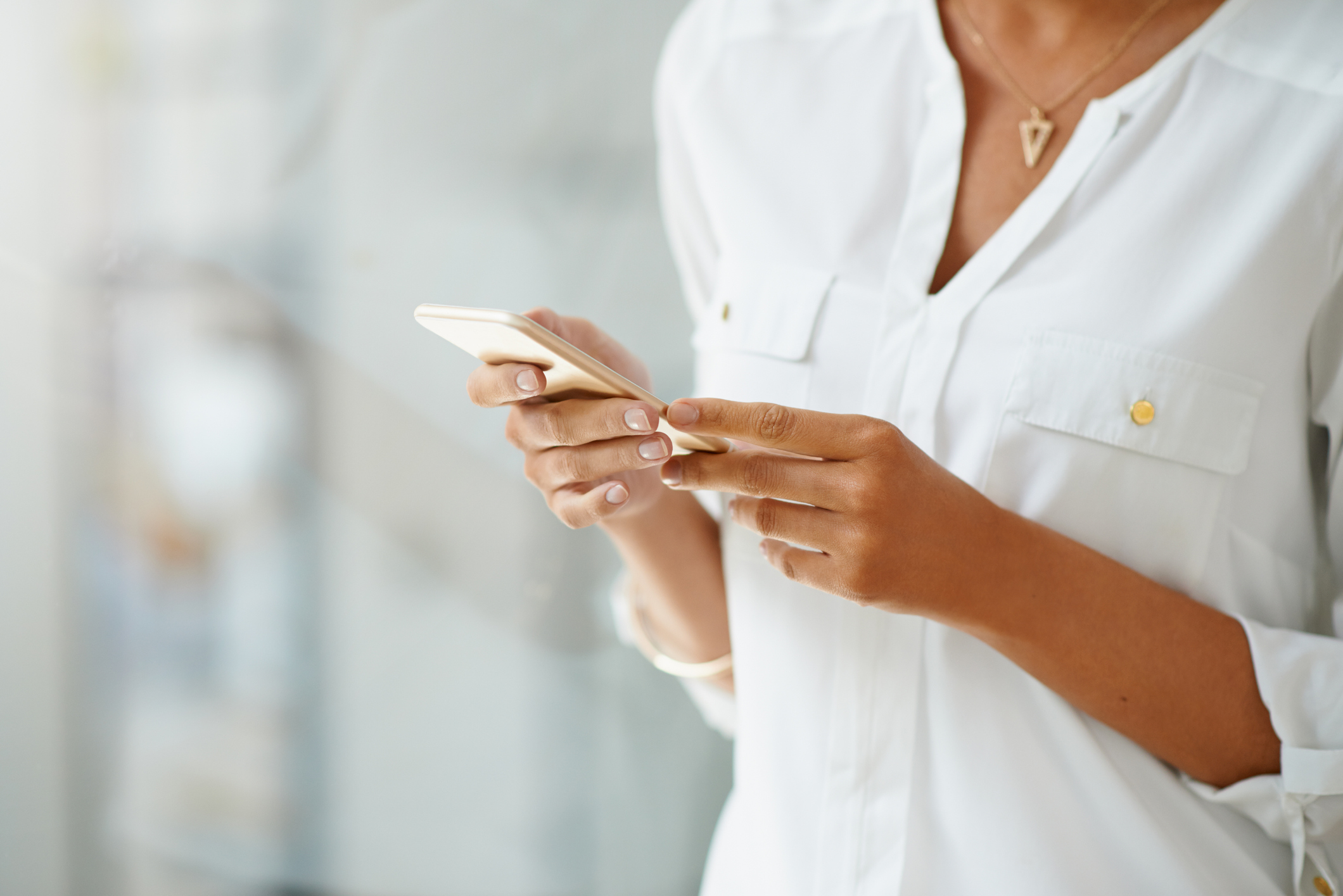 Cropped shot of a businesswoman using a smart phone at work